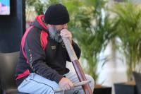Duncan Smith performs using the Digeridoo.