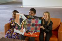 Josie, Orlando and Shae with the Our Land, Our Stories, Big Books at the launch at Parliament House.