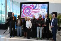 Guests and speakers at the Ngunnawal Welcome to Country launch at Canberra Airport.