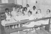 Missionaries and residents at their weekly meeting, Palm Island, QLD (c1966)