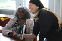 Lizzie signing copies of her book at the launch.