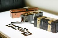 A collection of lantern slides and cases from the Reverend Ron Williams collection