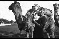 Mr A G Mathews with Keith. Start of camel expedition to Warburtons from Morgans, 7 June 1933.