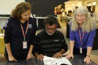 AIATSIS linguists Amanda Lissarrague (Collections – Print) and Rhonda Smith (Collections – Audio) with visitor Dr Ray Kelly, University of Newcastle