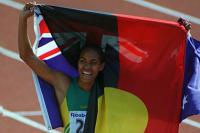 Cathy Freeman carrying the Australian Flag and Aboriginal flag after winning the 400 metre race at the Sydney Olympic Games.