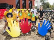 School children attend the Sea of Hands outside AIATSIS.