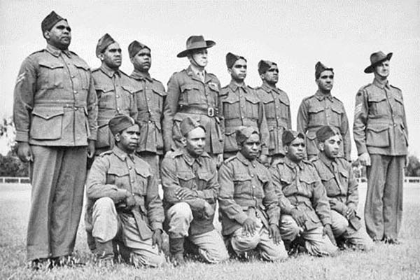 Group portrait of the special platoon consisting of Aboriginal soldiers, all volunteers, at Number 9 camp at Wangaratta with Corporal Mullett (left), Major Joseph Albert Wright (centre) and Sergeant Morris (right). Major Wright, a World War 1 Light Horse veteran, was in charge of this Platoon, which was the only Aboriginal squad in the Australian military forces.